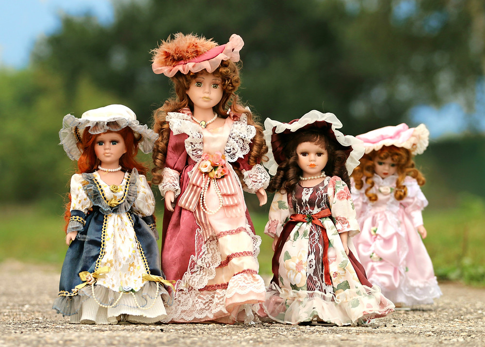 A collection of female dolls standing