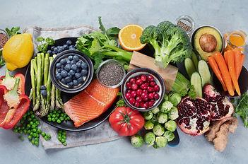 Healthy food selection on gray backgroun