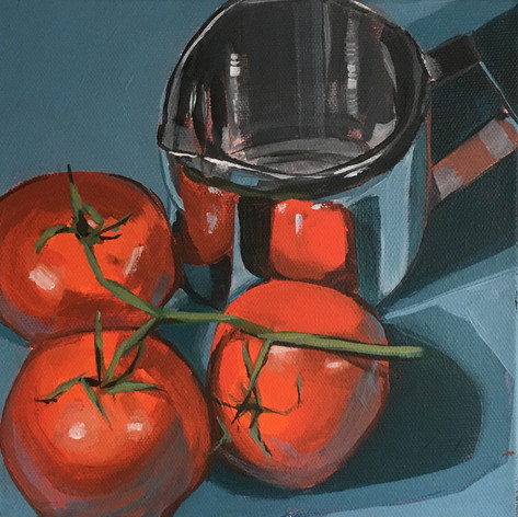 Tomatoes and metal jug
