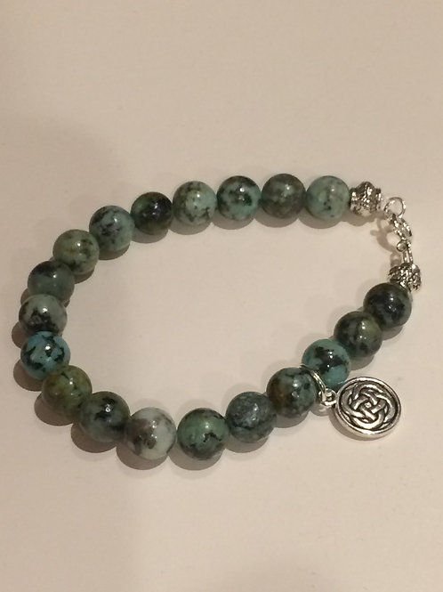 African Turquoise bracelet with Celtic Knot Charm