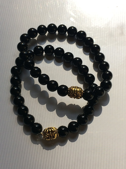 Black Onyx 8 mm round beads with Gold tone Bead