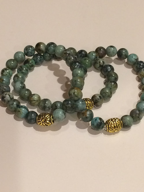 African Turquoise bracelet with gold tone bead