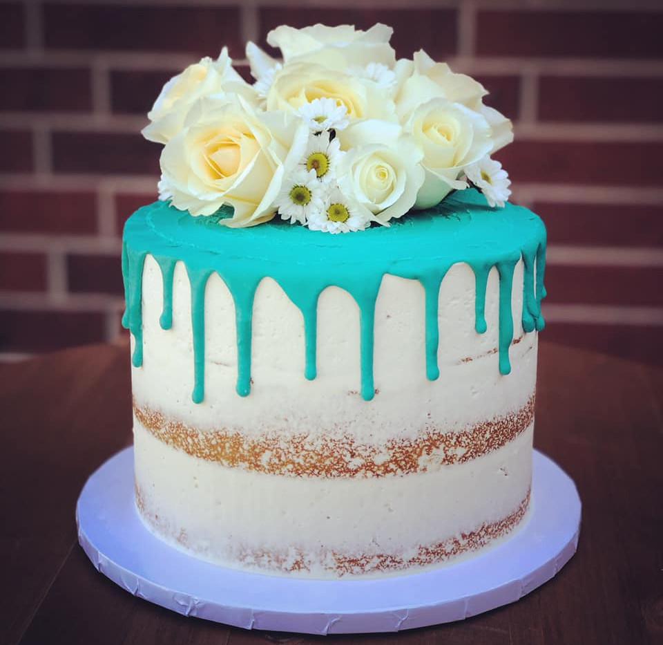 Teal Drip Floral Cake.jpg