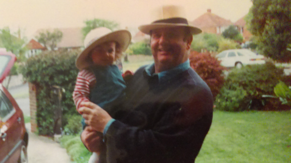 Grandfather and granddaughter wearing matching hats