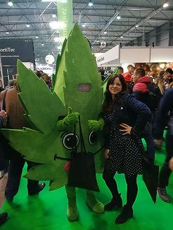 A cannabis writer called Zaneta Pacific posing with a cannabis leaf