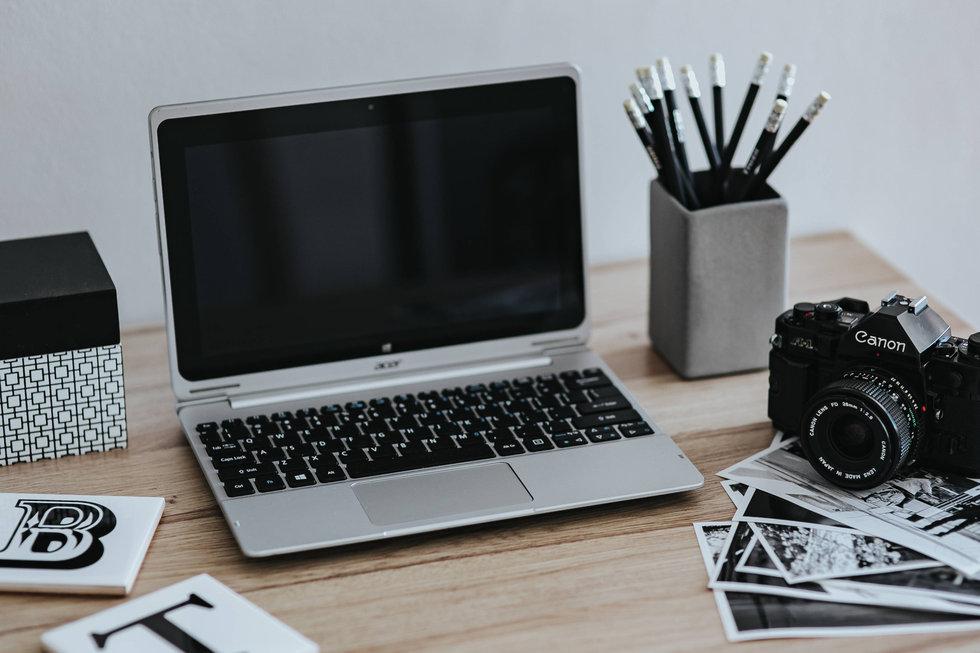 Laptop, camera and photos