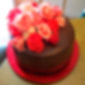 GANACHE COVERED CHOCOLATE ROSES CAKE