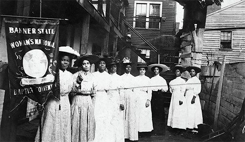 Suffrage leader Nannie Helen Burroughs, far left, and fellow suffragettes attend the Banner State Woman's National Baptist Convention in 1915. (Photo courtesy of the Library of Congress)