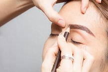 Drawing an eyebrow, applying permanent make up on