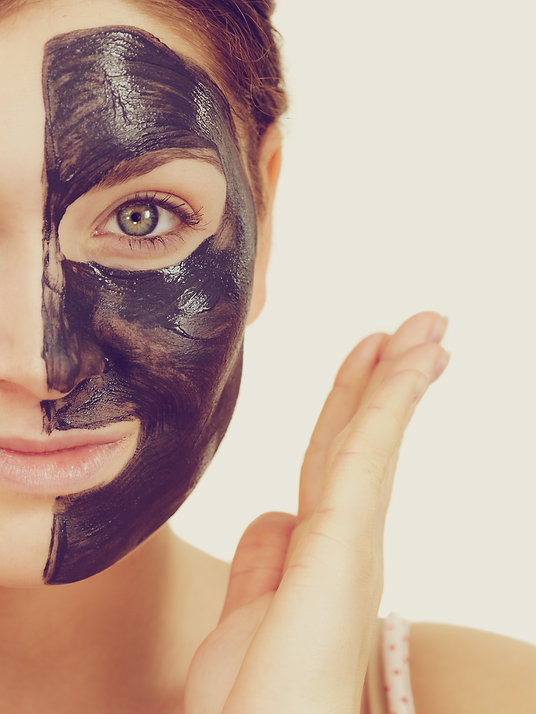 Woman with carbon detox black mask facial, laser carbon peel facial, oshawa, durham region