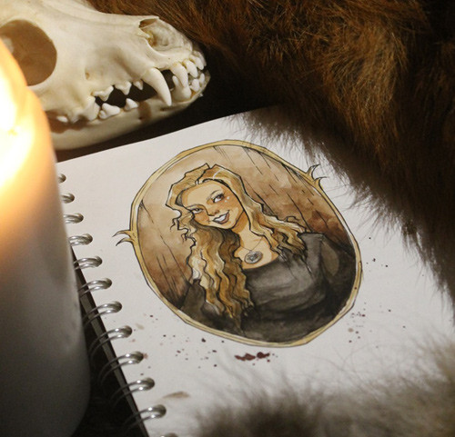 Color drawing of Lilith, flanked by a candle and skull