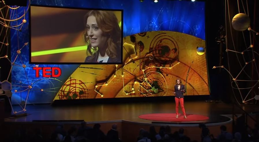 Kelly McGonigal is on stage with TED talk telling how to make stress your friend