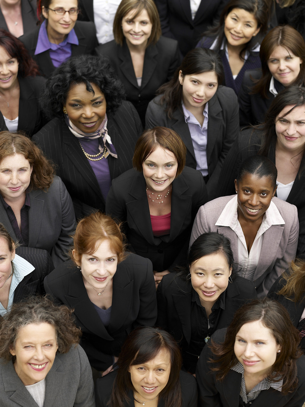 Group of business women looking up at the camera