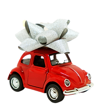Red VW Beetle with a big white bow on top to symbolize Delivery