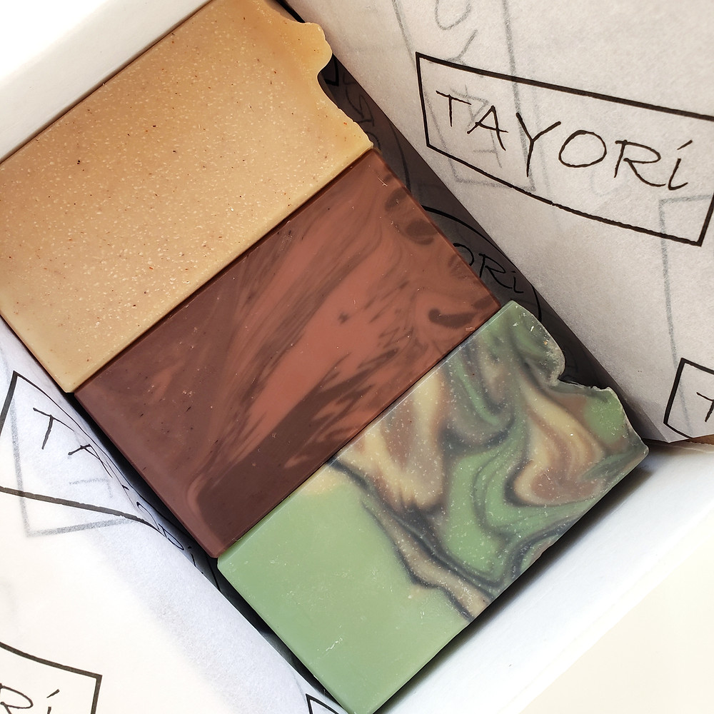 boxed set of 3 bars of soap, beige, brown & green respectively