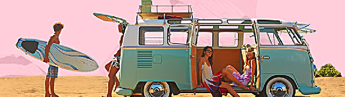 70's VW ban at the beach with young people hanging out around it
