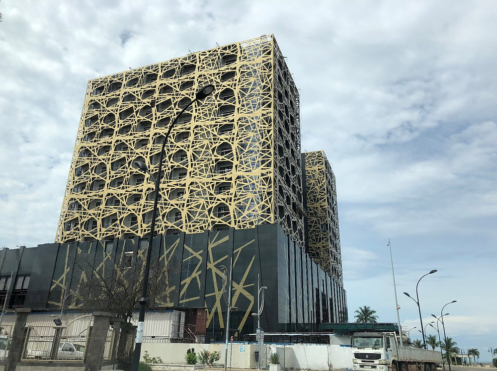 Cool high rise black and gold building in Bata