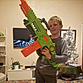 Jackson with his big Nerf gun.jpg