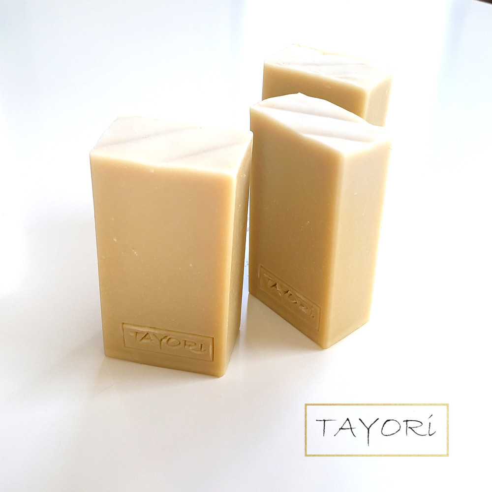 three bars of natural cream colored goat milk soap