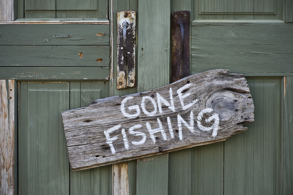 a sign that says 'Gone Fishing'