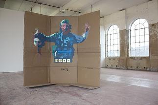 spray paint soldier head woman medusa on cardboard internet logos