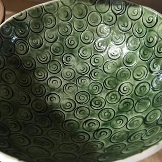 Large porcelain cast spiral bowl In bottle green glaze