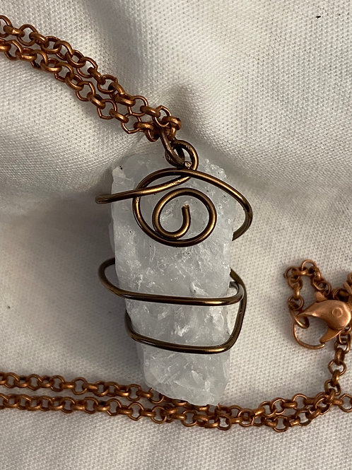 Wire wrapped raw crystal