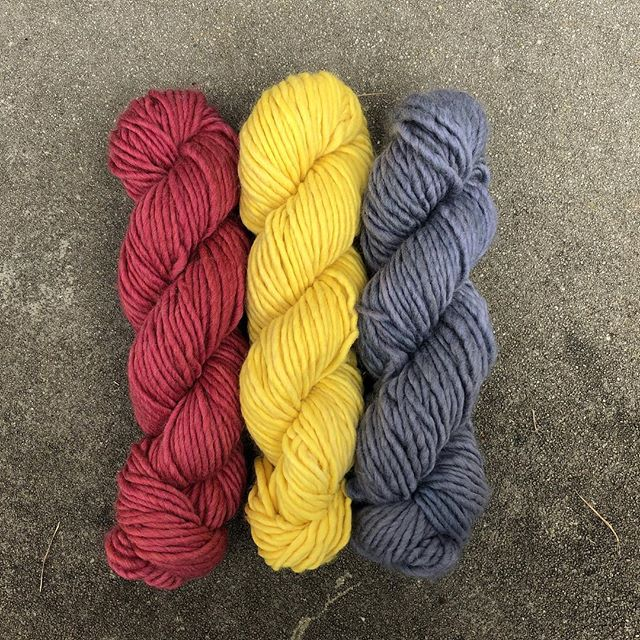 red yellow and blue skeins of yarn