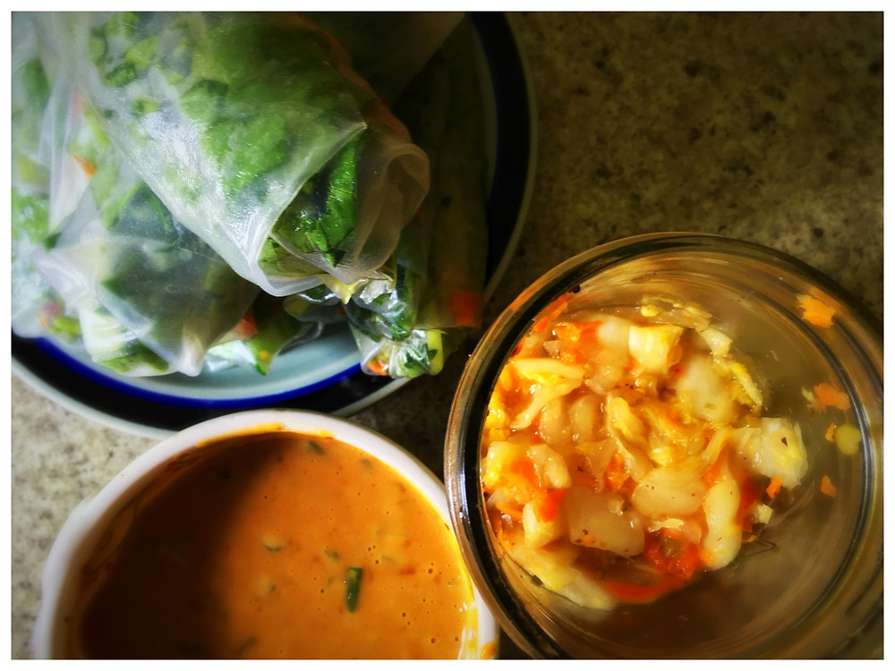 Spring rolls with a side of Camper Kimchi & peanut sauce.