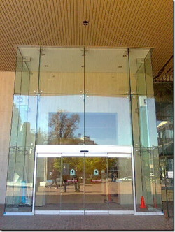 Broadway Plaza Floating All Glass Slider attached only at sill