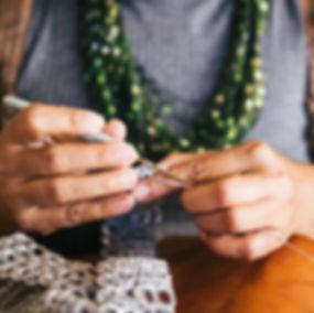 person-holding-crochet-hook-2897128.jpg