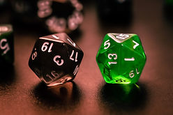 Two twenty-sided dice on a table
