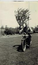 Reg on motorbike.png