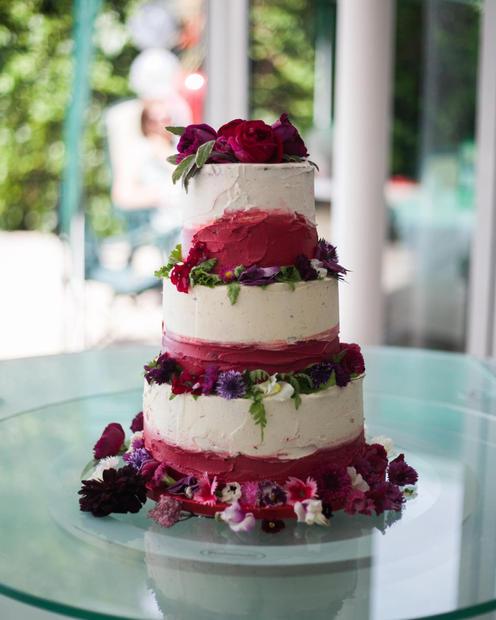 3 tier red velvet cake with buttercream finish and fresh edible flowers