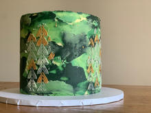 4 layer, chocolate sponge, finished with abstract green buttercream, stencil detail and touches of edible gold paint