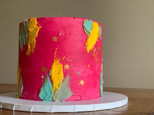 4 layer Victoria sponge finished with abstract effect buttercream, touches of edible gold paint and sprinkles