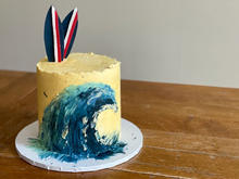 4 layer chocolate cake finished with Swiss meringue buttercream and topped with fondant surfboards