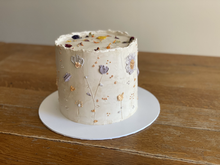 4 layer, gluten free lemon sponge, filled with lemon cream and covered in Swiss meringue buttercream. Finished with buttercream flowers, gold sprinkles and edible dried petals.