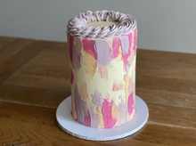 6 layer, raspberry sponge, filled with raspberry jam and white chocolate ganache. Covered in American buttercream and finished with abstract decoration and piping detail on top.