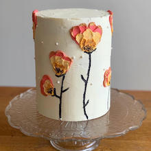 6 layer lemon cake with buttercream finish, buttercream flowers, touches of edible gold paint and sprinkles