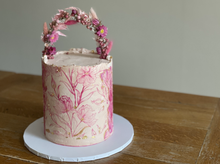 4 layer chocolate sponge, filled with dark chocolate ganache and raspberry coulis. Finished with swiss meringue buttercream, stencil detail, touches of gold leaf, abstract buttercream decoration and topped with a dried flower arch