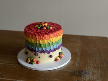 4 layer gluten free lemon sponge, filled with lemon curd. Finished with rainbow buttercream and rainbow sweets