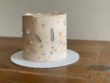 4 layer lemon sponge, filled with lemon curd. Finished with American buttercream and floral decorations.