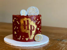 4 layer victoria sponge, finished with buttecream, gold edible paint, sprinkles and fondant decorations