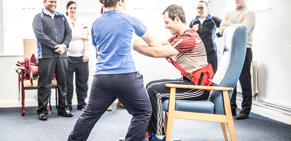Handling belt assisted sit to stand practice with Fit For Life.