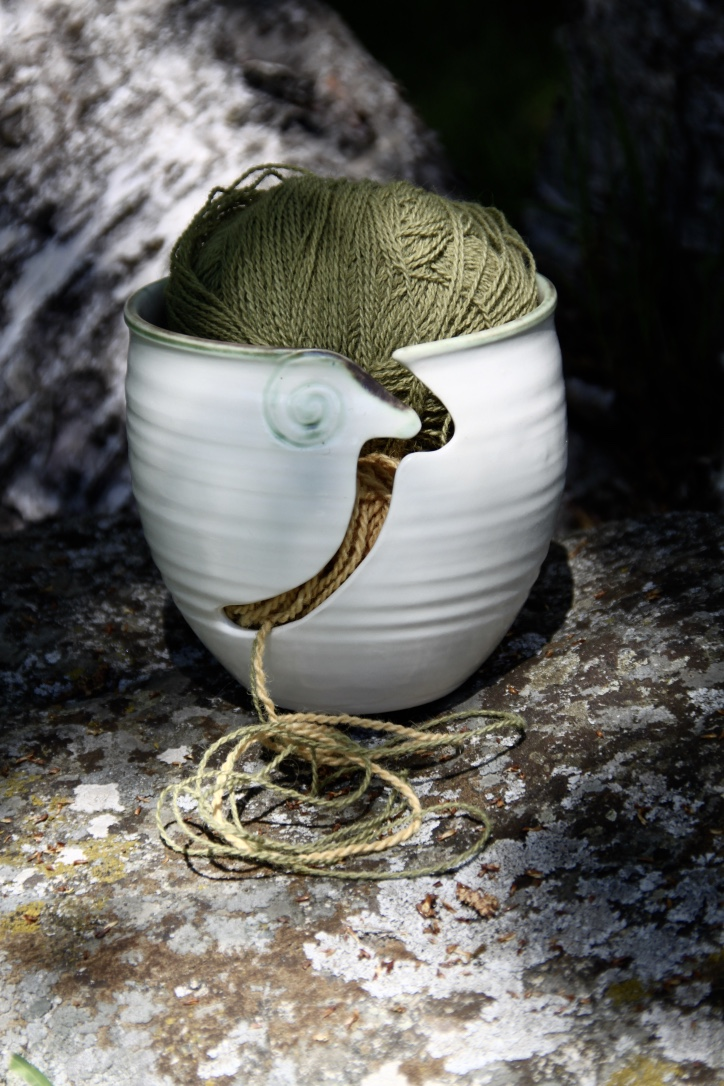 Cup for yarn with The Ram design