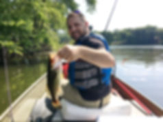 Moe with his Large Mouth Bass fishing with Bob and his Go Fishing Guide Service.