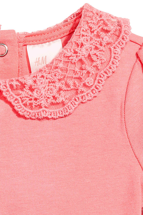 Mesh lace used as collar for Bodysuit