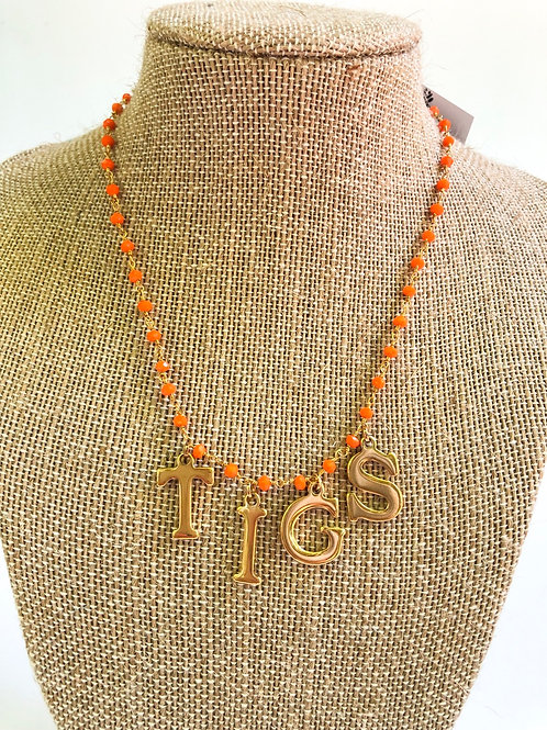 TIGS necklace on orange chain