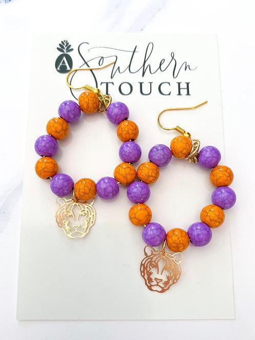 Beaded Tiger earrings in orange and purple